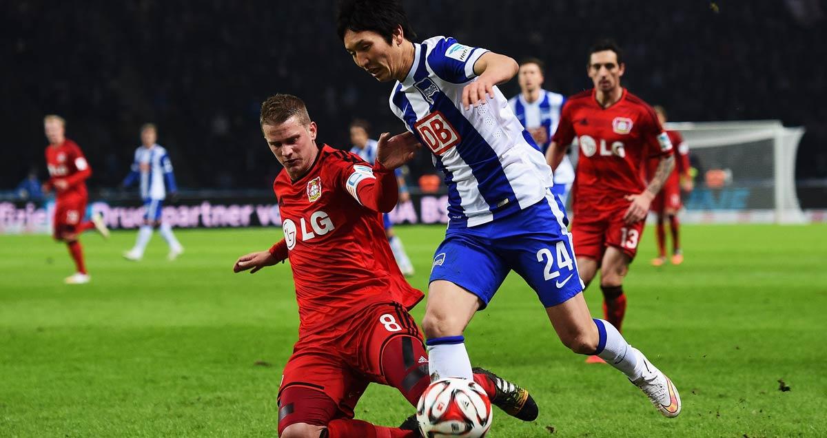 Bayer Leverkusen's Lars Bender (left) in action against Hertha Berlin