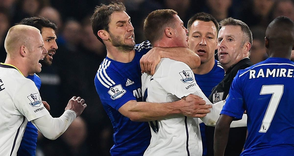 Branislav Ivanovic of Chelsea puts a friendly arm around Everton's James McCarthy