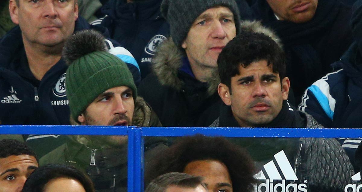 Cesc Fabregas and Diego Costa watch Chelsea from the Stamford Bridge stands