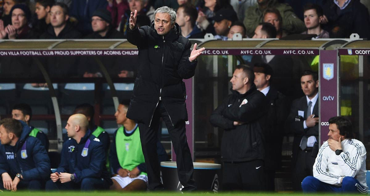 Chelsea manager Jose Mourinho struggles in vain to avoid defeat against Aston Villa at Villa Park in 2013-14