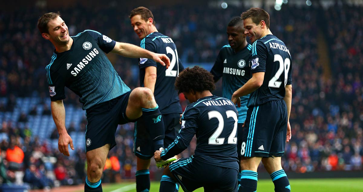 Chelsea's Willian gives Branislav Ivanovic's boots a shine after his winner against Aston Villa