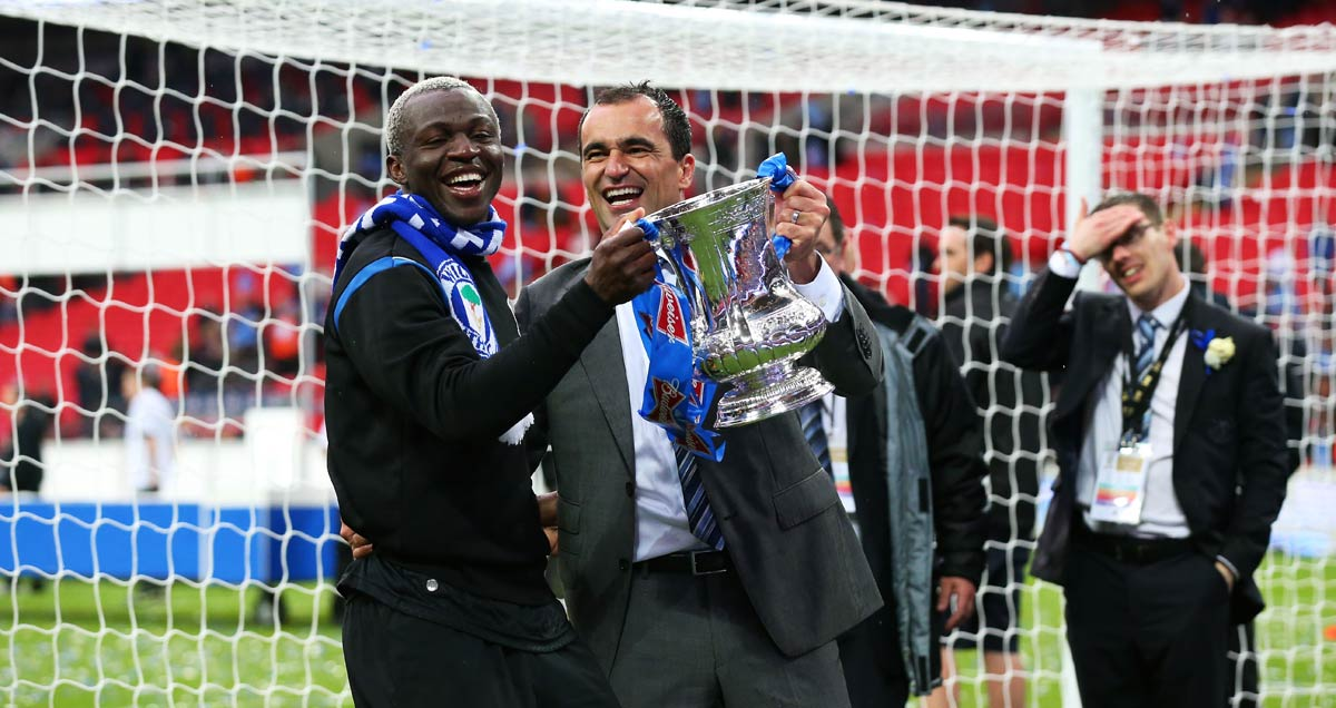 Everton manager Roberto Martinez celebrates winnign the FA Cup with Wigan