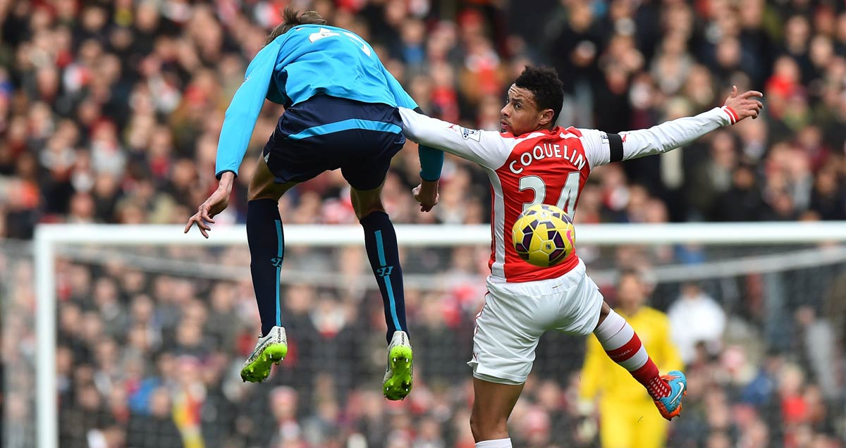 Francis Coquelin wins an aerial duel in the home win against Stoke