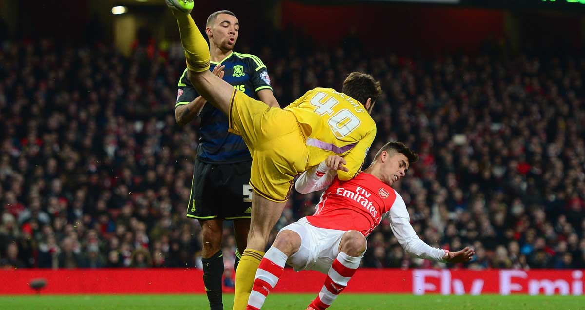 Gabriel-Paulista-of-Arsenal-clashes-with-Middlesbrough-keeper-Mejias