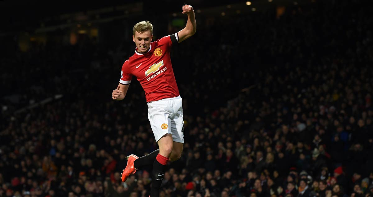 James Wilson leaps into the air to celebrate scoring against Cambridge