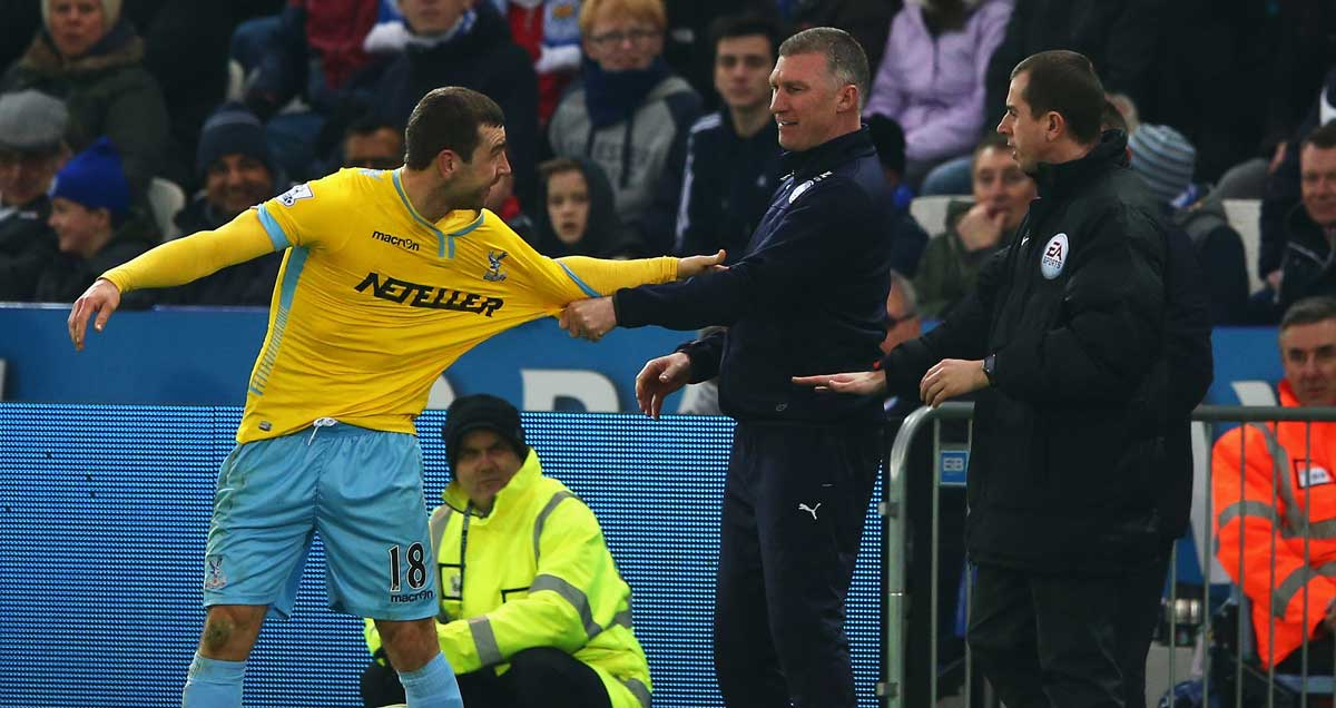 Leicester boss Nigel Pearson grapples with Crystal Palace's James McArthur