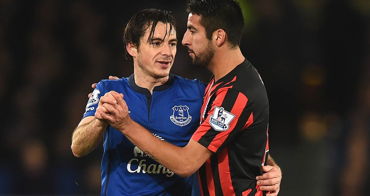 Leighton Baines of Everton shares an impromptu foxtrot with QPR's Mauricio Isla