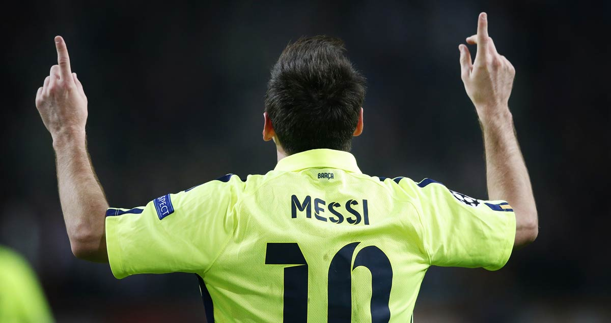 Lionel Messi celebrates finding the net against Ajax