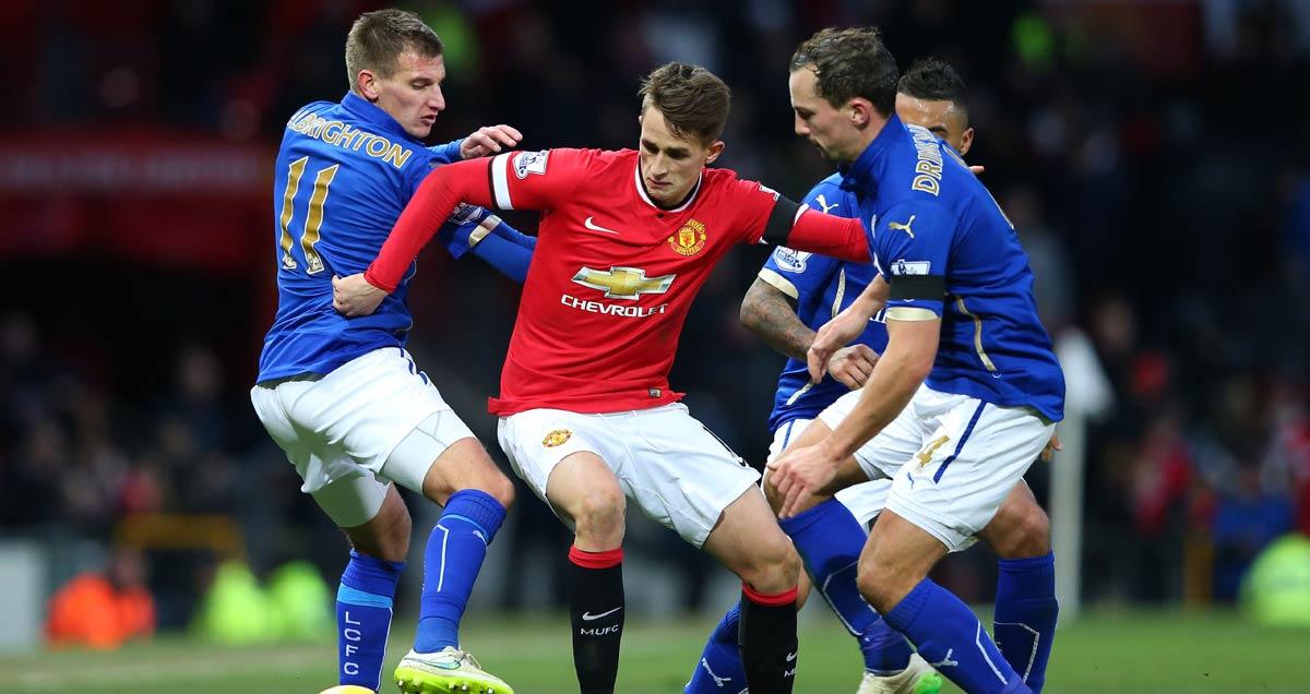 Man Utd man Adnan Januzaj surrounded by   massed Leicester defenders