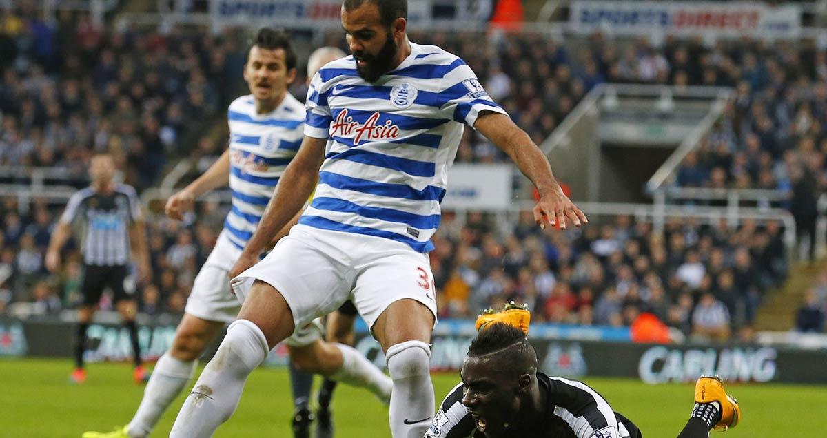 QPR's Sandro sends Massadio Haidara of Newcastle flying