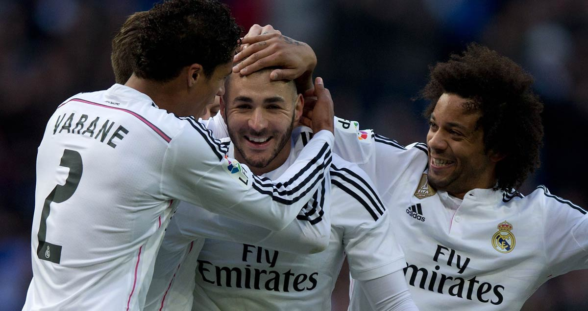 Raphael Varane and Marcelo congratulate Karim Benzema on his scoring against Real Sociedad