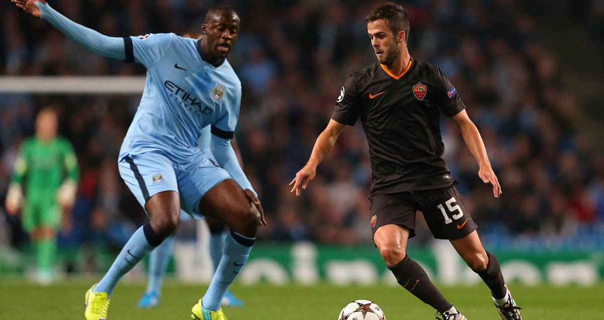 Roma's Miralem Pjanic in Champions League action against Yaya Toure of Manchester City