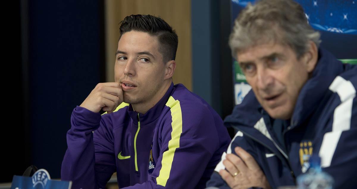 Samir Nasri and Manuel Pellegrini at a Man City press conference