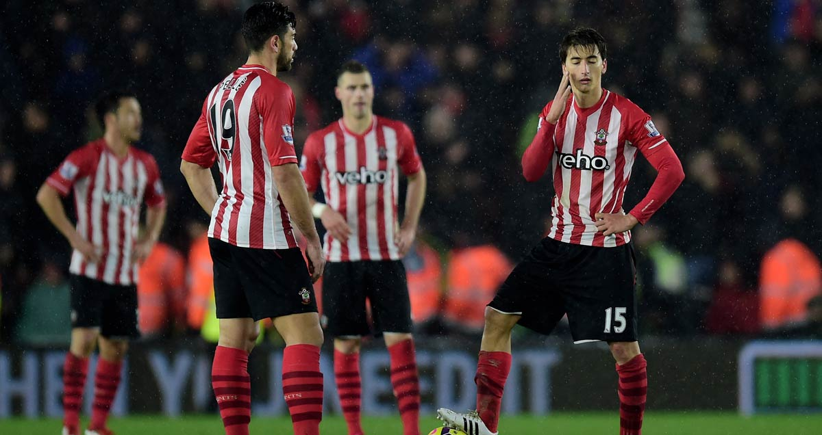 Southampton players look on dejected after a Liverpool goal