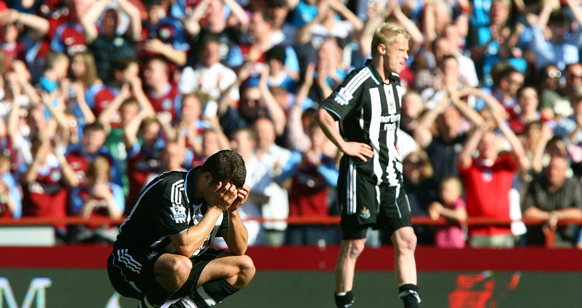 Steven Taylor and Damien Duff react to Newcastle's relegation at Villa Park in 2009