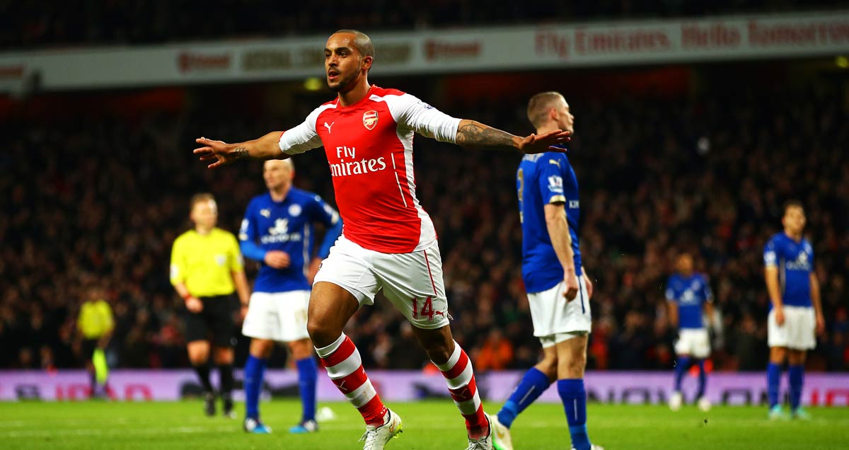 Theo Walcott nets the decisive goal in Arsenal's 2-1 win over Leicester