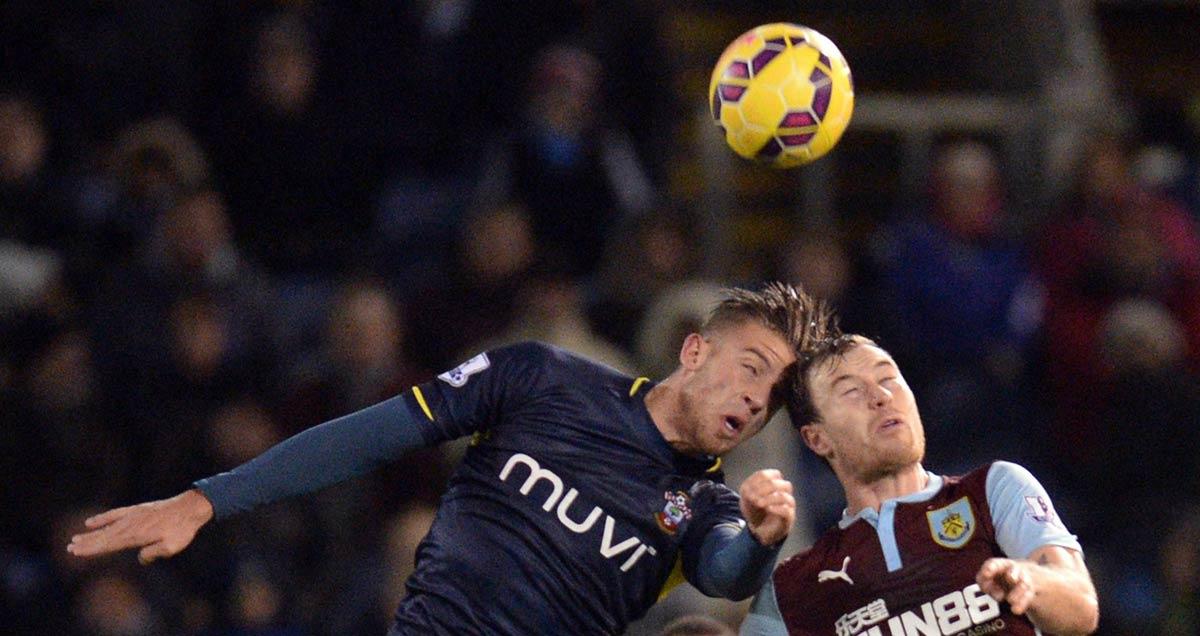 Toby Alderweireld of Southampton wins a header against Ashley Barnes of Burnley