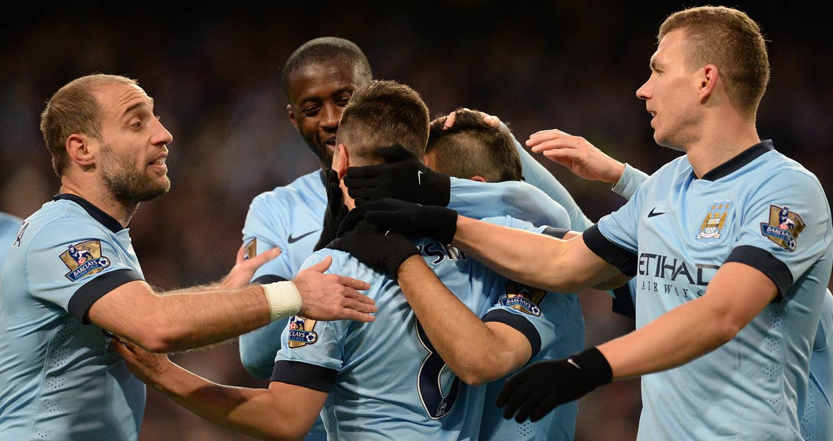 Yaya Toure and his Manchester City colleagues congratulate Samir Nasri