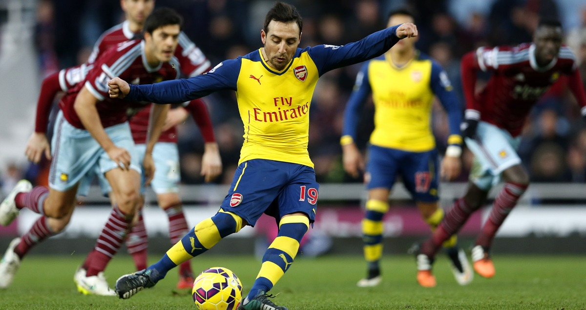 Arsenal's Santi Cazorla strikes his goalbound penalty against West Ham