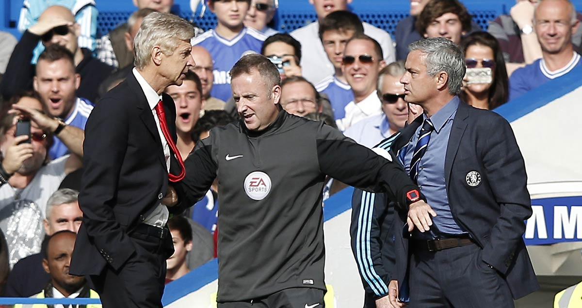Arsene-Wenger-and-Jose-Mourinho-square-up-with-hands-in-their-pockets-