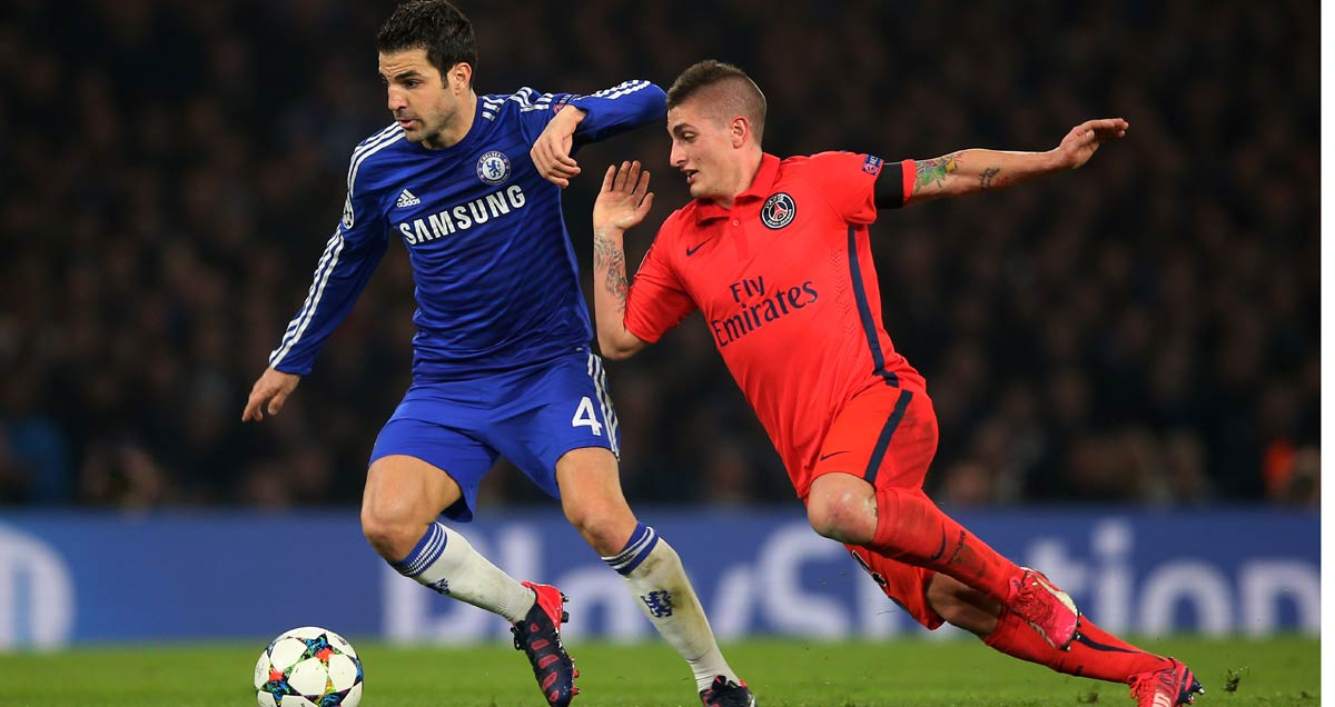 Chelsea v PSG Cesc Fabregas is closed down by Marco Verratti