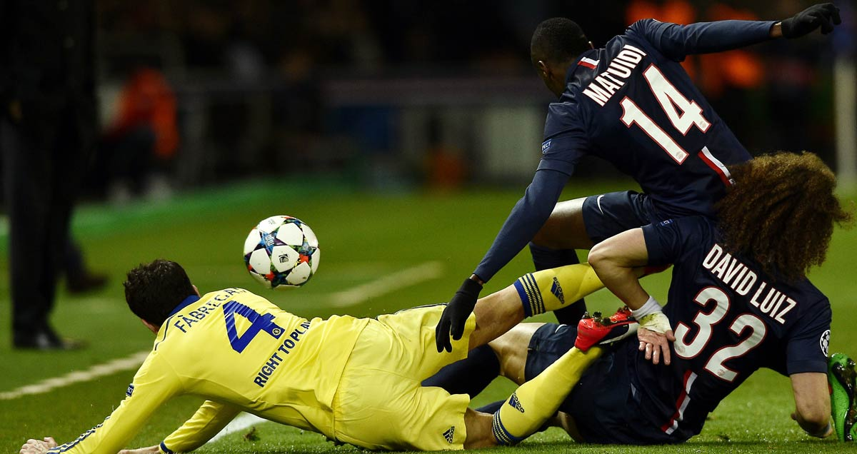 Chelsea's Cesc Fabregas tangles with Blaise Matuidi and David Luiz of PSG