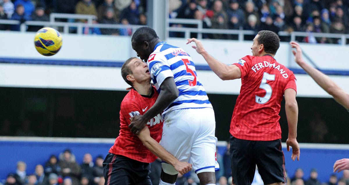 Chris Samba wins a header for QPR against Man Utd