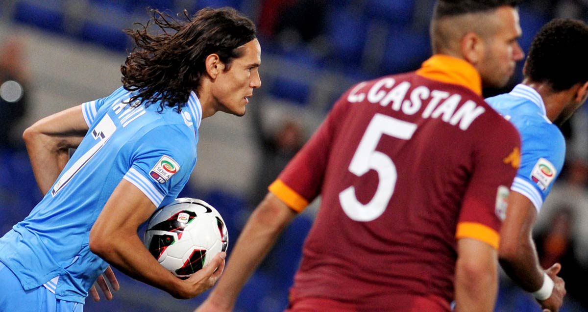 Cavani retrieves the ball after scoring for Napoli against Roma