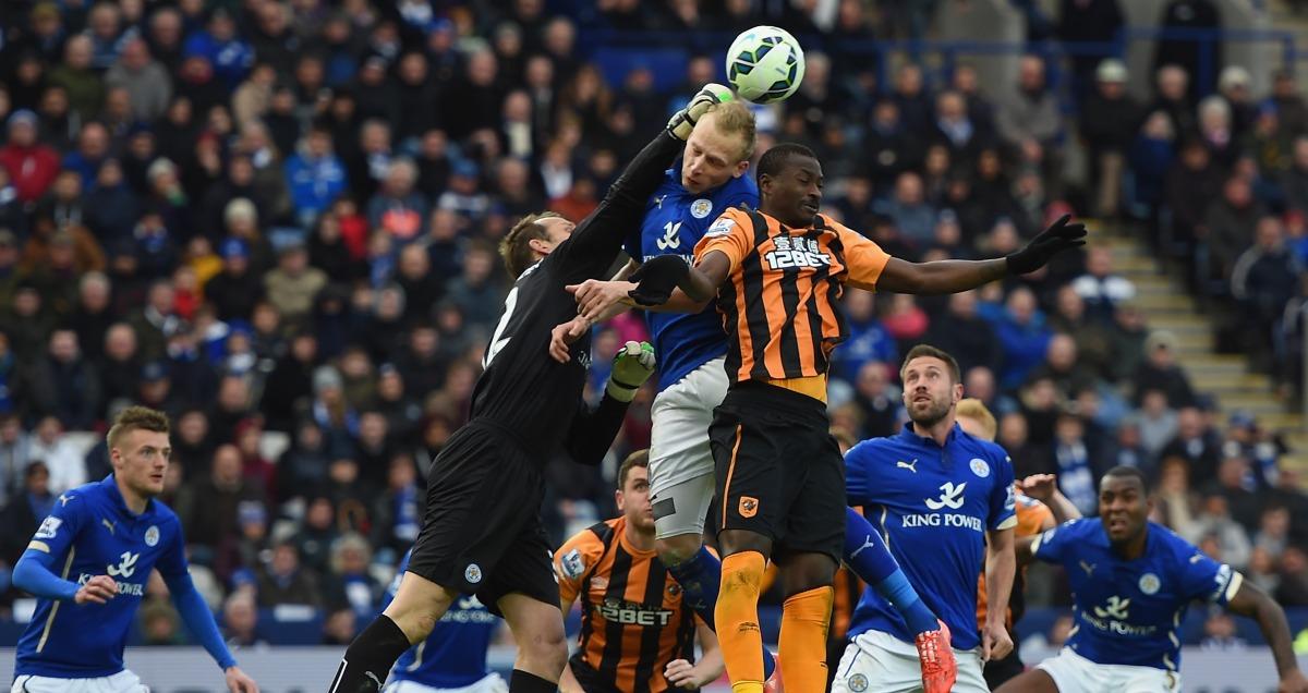 Hull striker Dame N'Doye leaps for a cross against Leicester