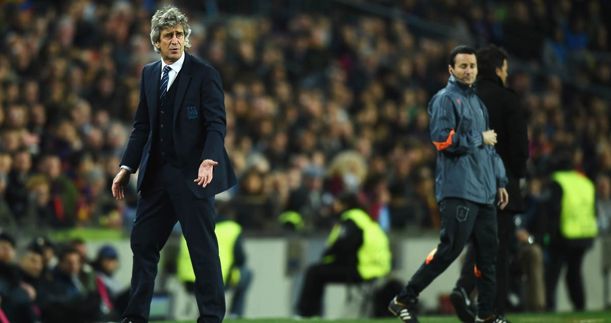 Man City manager Manuel Pellegrini stalks the Camp Nou touchline