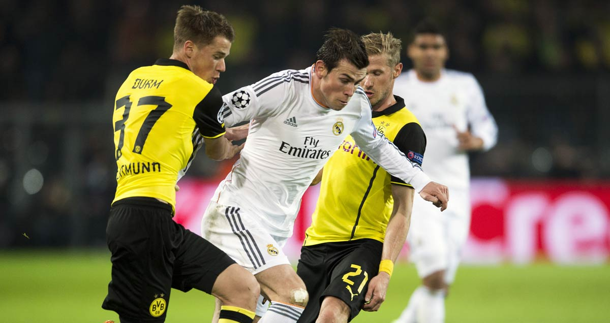 Oliver Kutch and Erik Durm of Borussia Dortmund close down Gareth Bale of Real Madrid