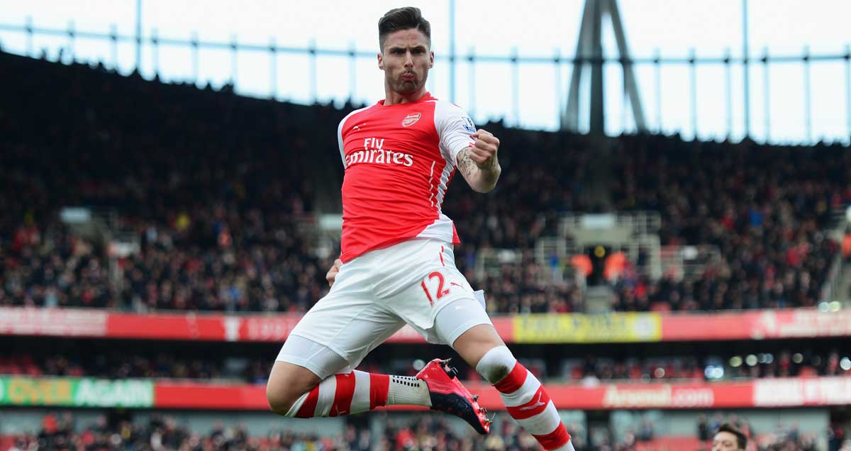 Olivier Giroud uppercuts the air after scoring against West Ham