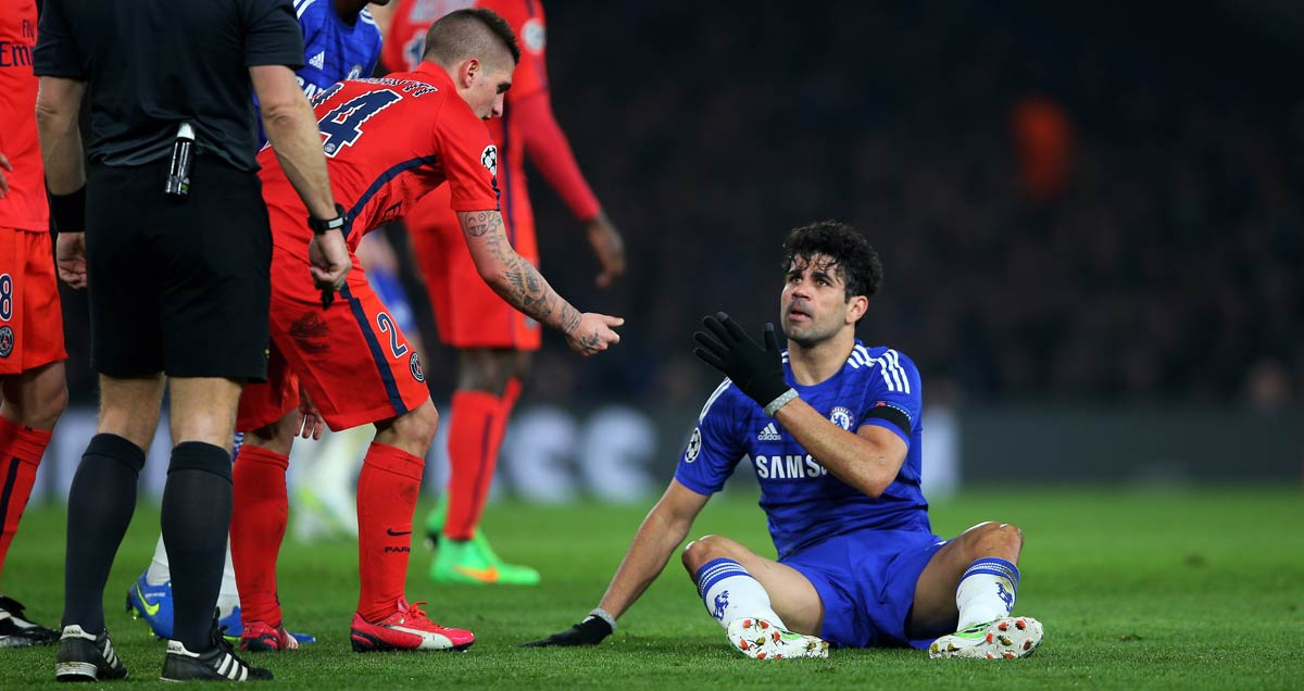 PSG midfielder Marco Verratti offers Diego Costa of Chelsea a hand