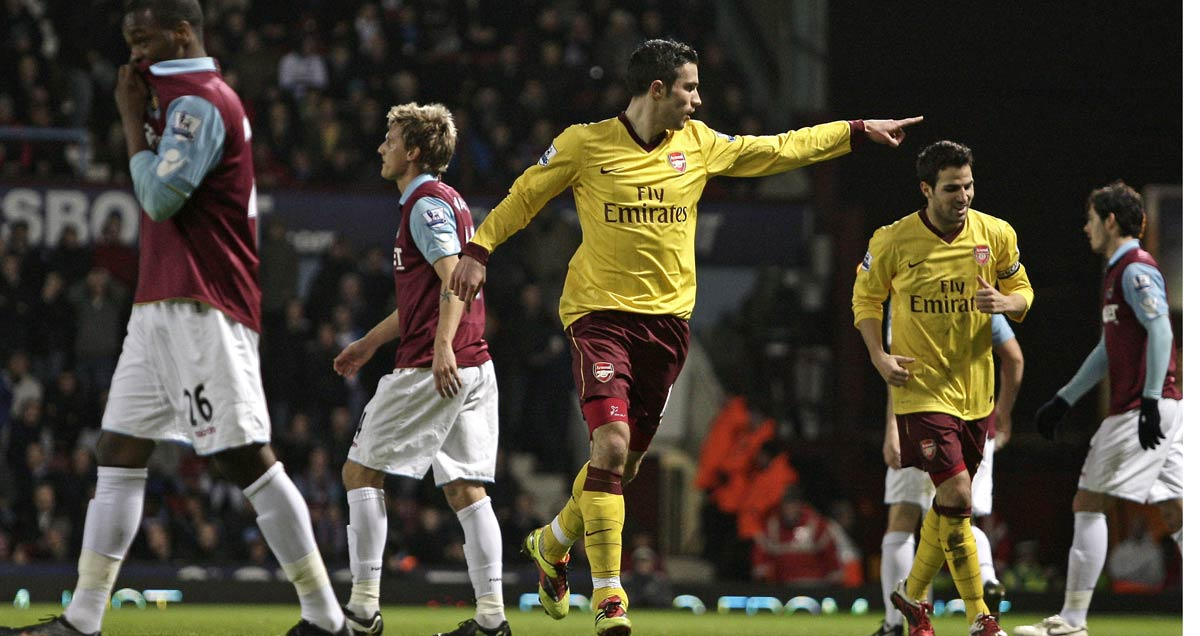 Robin van Persie scores against West Ham during his record nine away game scoring streak