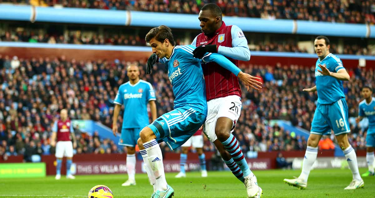 Santiago Vergini wrestles with Aston Villa marksman Christian Benteke