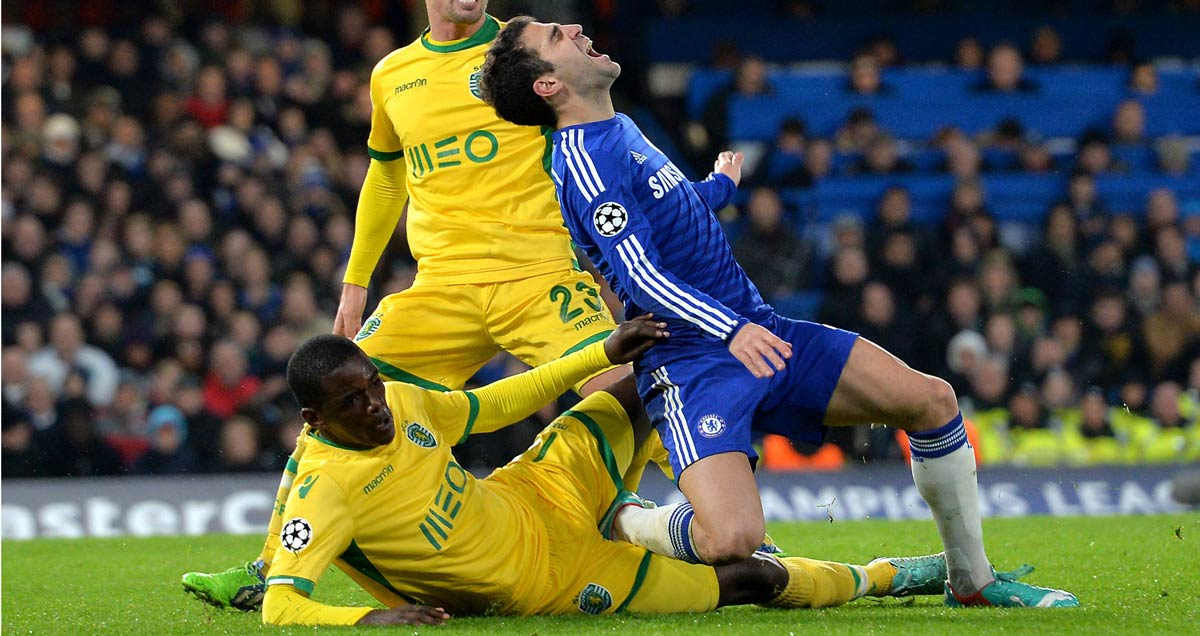Sporting v Chelsea William Carvalho slides in on Cesc Fabregas