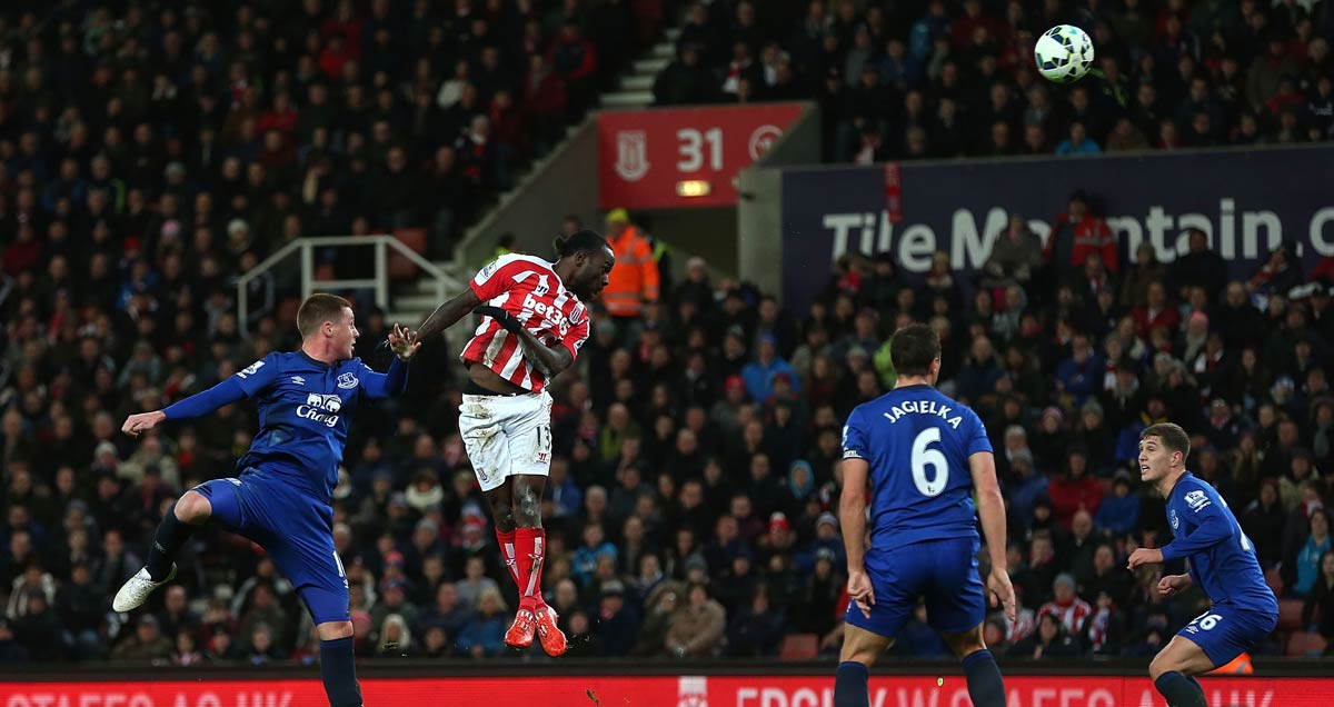 Stoke's Victor Moses rises to head in the opener against Everton