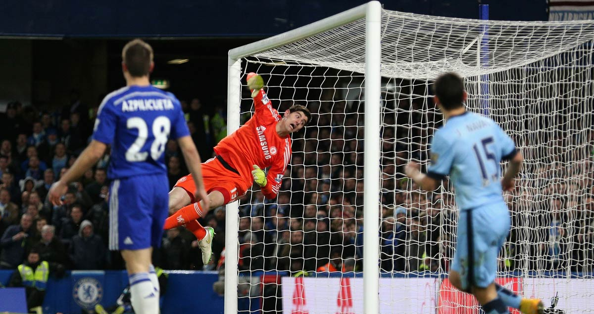Thibaut Courtois makes a save for Chelsea v Man City