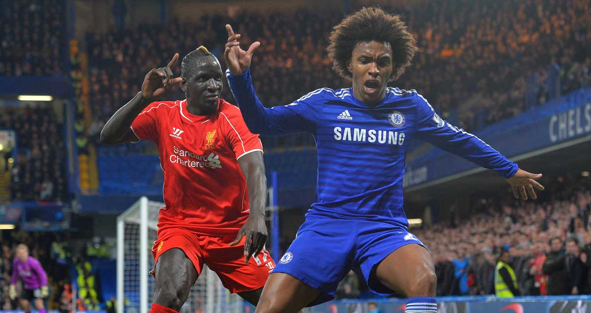 Willian goes down under the challenge of Liverpool's Mamadou Sakho