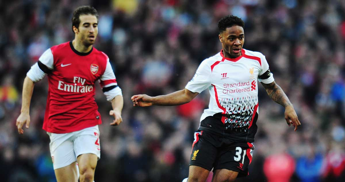 Raheem Sterling vying to escape the clutches of Arsenal's Mathieu Flamini