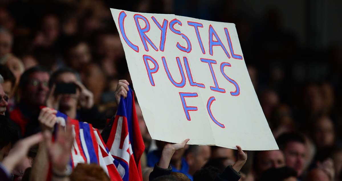 Crystal Palace fans hold a sign depicting their reverence for Tony Pulis aloft