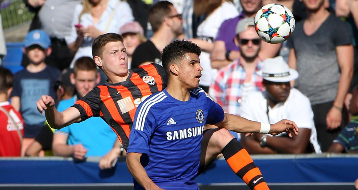Chelsea prodigy Dominic Solanke holds off a Shakhtar Donetsk youth defender