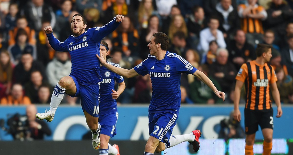 Eden Hazard leaps in the Hull air after scoring against the Tigers