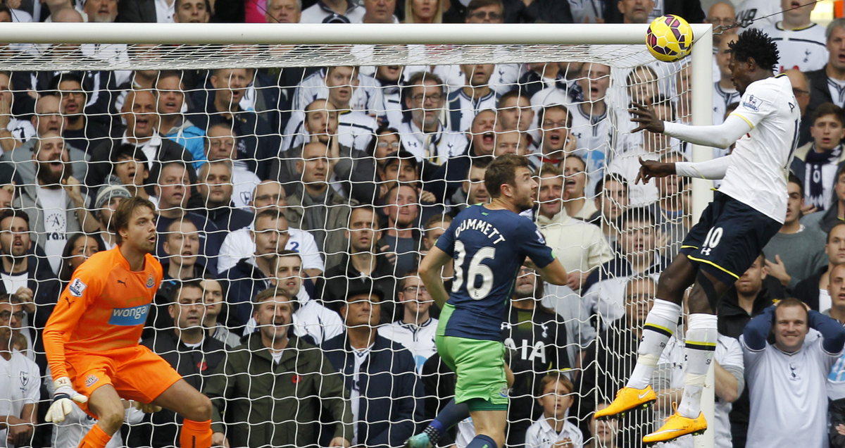 Emmanuel Adebayor scores one of his countless goals against Newcastle for Tottenham