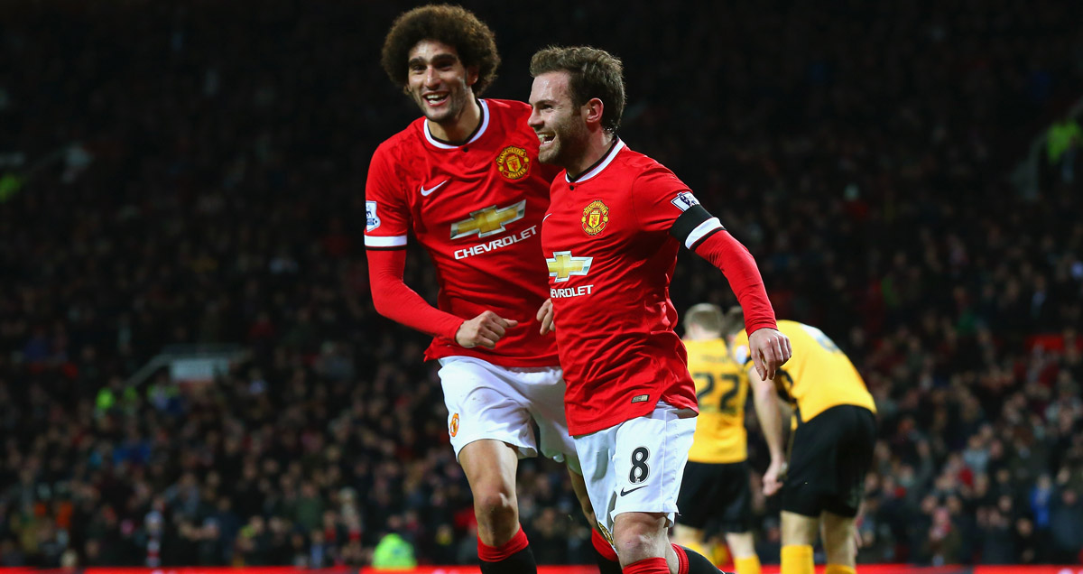 Marouane Fellaini and Juan Mata celebrate