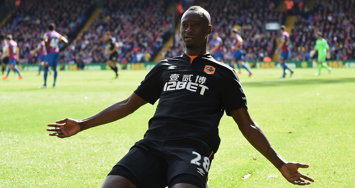 Hull striker Dame N'Doye celebrates a goal at Crystal Palace