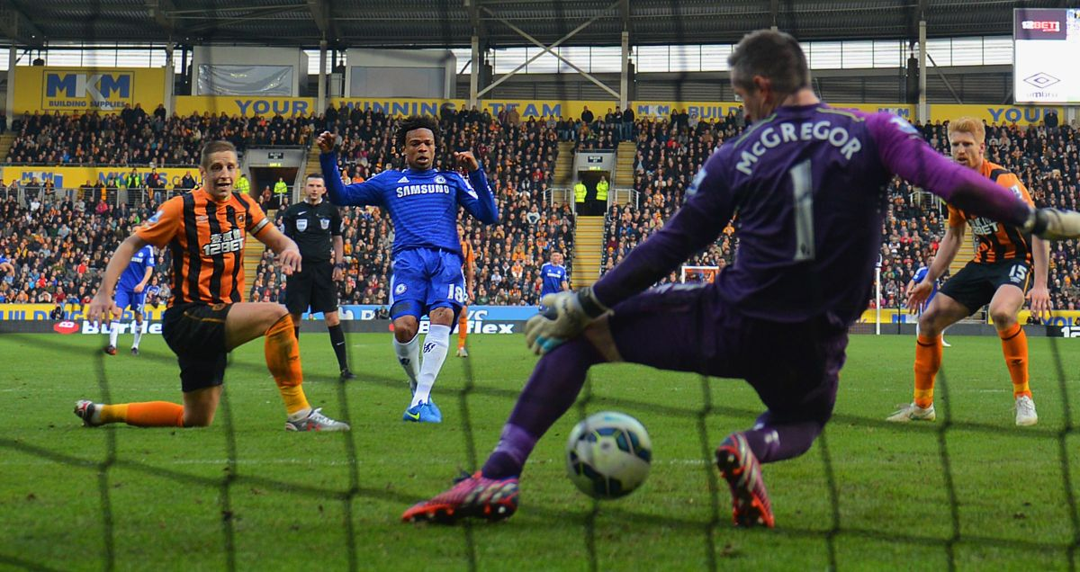 Hull goalkeeper Allan McGregor allows a shot from Chelsea man Loic Remy through his legs