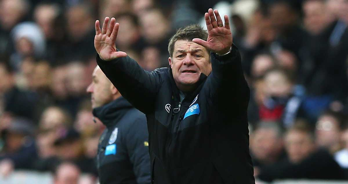 Newcastle manager John Carver reaches for the sky