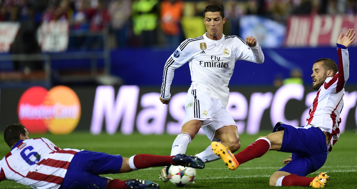 Real-Madrid's-Cristiano-Ronaldo-runs-into-massed-Atletico-madrid-ranks