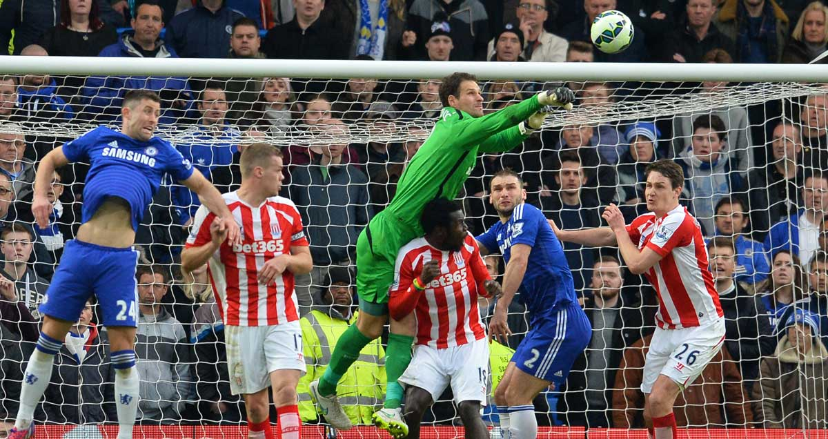 Stoke goalkeeper Asmir Begovic punches the ball clear against Chelsea